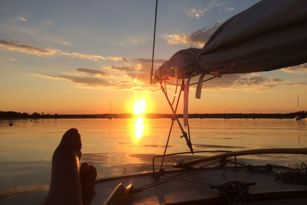 sunset boats and bare feet