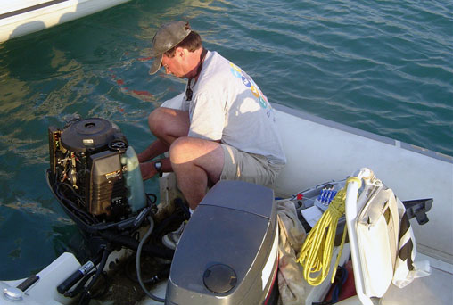 Once the Olympics begins, a coach's primary job is to eliminate distractions. At Athens 2004, that included coach boat outboard repair by Gary Bodie.