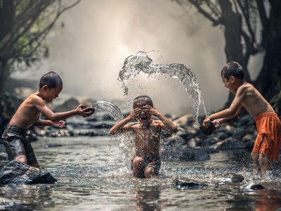 children laughing water splashing