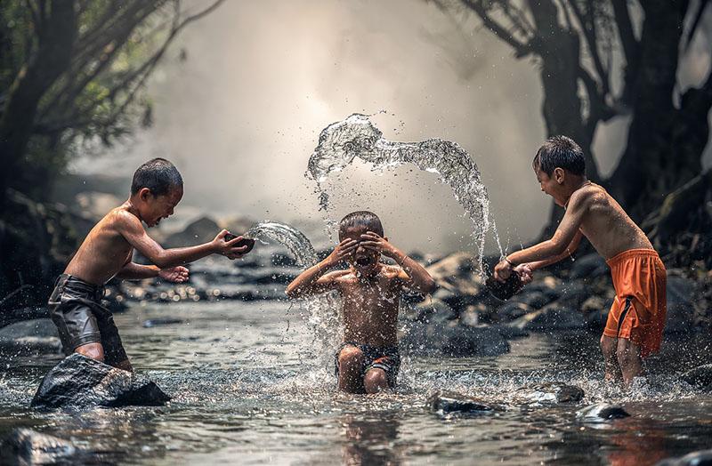 children laughing water splashing