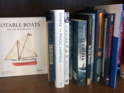 books on shelf at Island Books, including Finding Pax